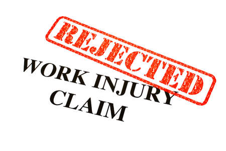 A close-up of a REJECTED Work Injury Claim document. Stock Photo - 18022039