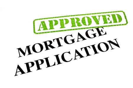 A close-up of an APPROVED Mortgage Application document. photo