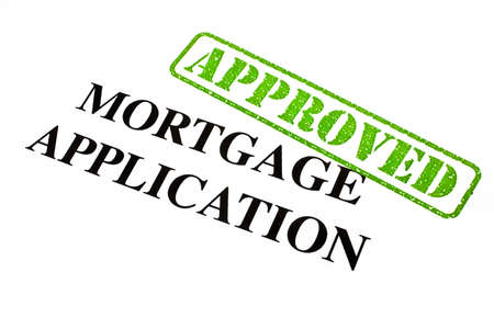 financial agreement: A close-up of an APPROVED Mortgage Application document.
