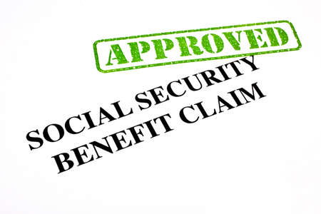 handout: A close-up of an APPROVED Social Security Benefit Claim document.
