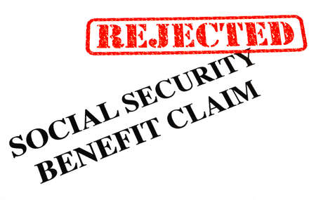 handout: A close-up of a REJECTED Social Security Benefit Claim document.