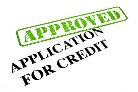 A close-up of an APPROVED Credit Application document. Stock Photo - 18022003