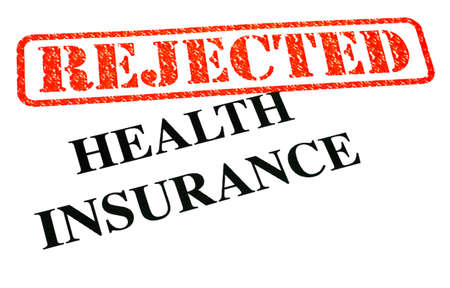 unapproved: A close-up of a REJECTED Health Insurance document.