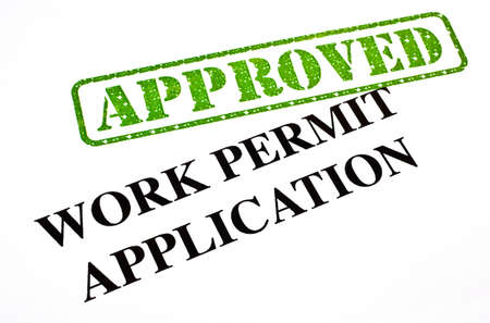 A close-up of an APPROVED Work Permit Application document  Stock Photo