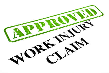 A close-up of an APPROVED Work Injury Claim document  photo