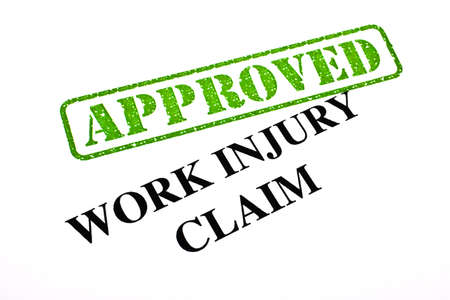 A close-up of an APPROVED Work Injury Claim document Stock Photo - 18021994