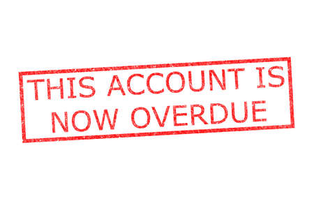 accounts payable: THIS ACCOUNT IS NOW OVERDUE rubber stamp over a white background. Stock Photo