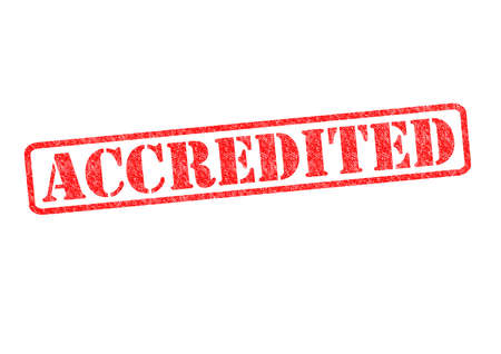 rewarded: ACCREDITED rubber stamp over a white background. Stock Photo