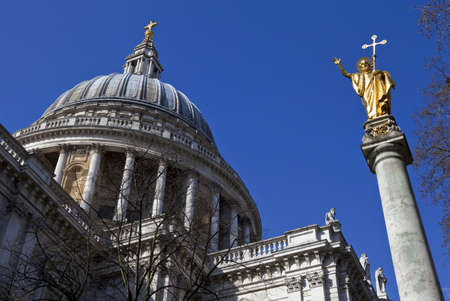 Looking up at the impressive dome of St. Paul's Cathedral and the Statue of Saint Paul in London. Stock Photo - 19412314