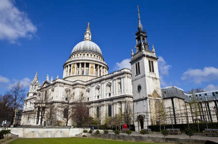 saint pauls cathedral: St. Pauls Cathedral and the Tower of the former St. Augustine Church (now the St. Pauls Cathedral Choir School) in London. Stock Photo