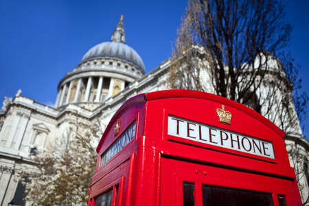 An iconic British Red Telephone Box outside St. Paul's Cathedral in London photo
