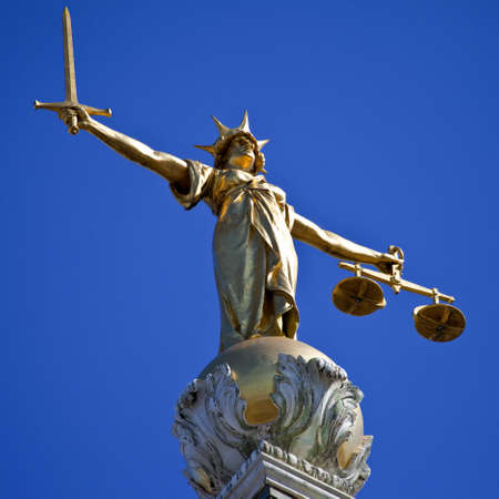 law scale: The magnificent Lady Justice statue ontop of the Old Bailey (Central Criminal Court of England and Wales) in London.