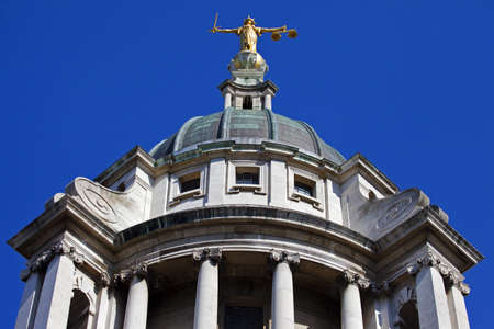 Looking up at the Lady Justice statue ontop of the Old Bailey in London.