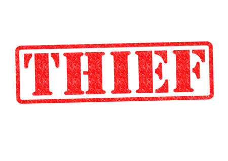 kidnap: THIEF Rubber Stamp over a white background. Stock Photo