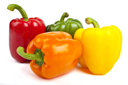 Four Bell Peppers over a white background  photo