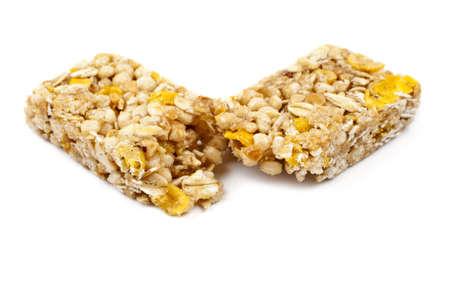 barra de cereal: Una barra de cereal sobre un fondo blanco. Foto de archivo
