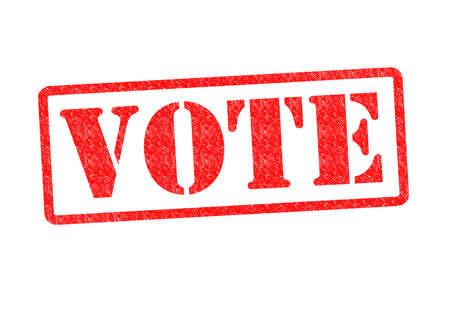 VOTE Rubber Stamp over a white background. photo