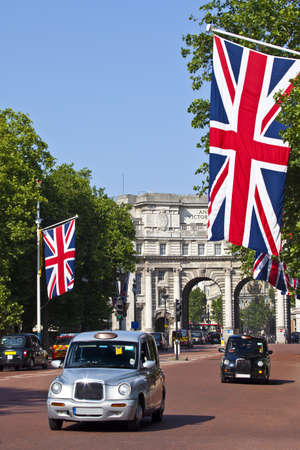 London Taxis drive up The Mall with Admiralty Arch in the background