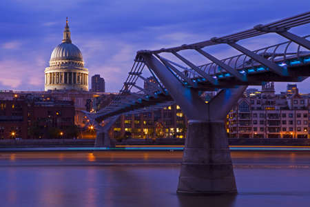St. Pauls Cathedral and the Millennium Bridge at dusk. photo