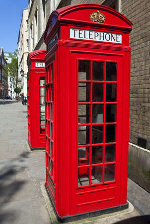 pay phone: Iconic red telephone boxes in London  Stock Photo