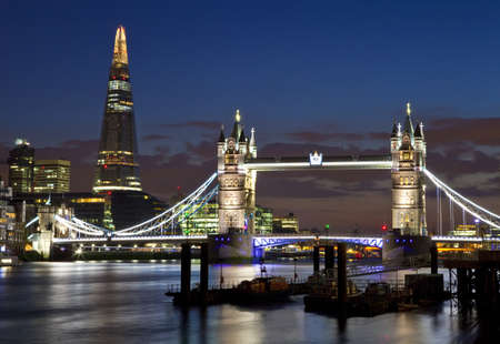 A magnificent view of Tower Bridge, the Shard and the River Thames in London  photo