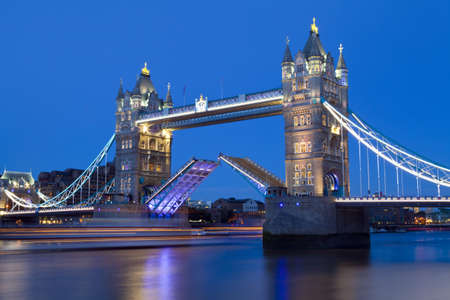 tower bridge: Tower Bridge opens to let a ship pass underneath    Editorial