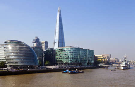 View from Tower Bridge taking in the sights of The Shard, City Hall, HMS Belfast and the River Thames in London  photo