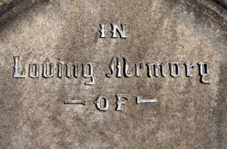 inscribed: In Loving Memory inscribed on a gravestone.