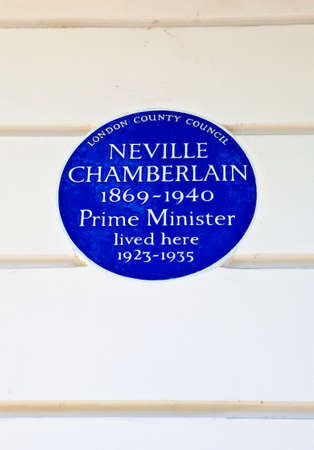 blue plaque: Blue plaque marking the former residence of Neville Chamberlain - a former Prime Minister