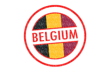 Passport-style BELGIUM rubber stamp over a white. photo