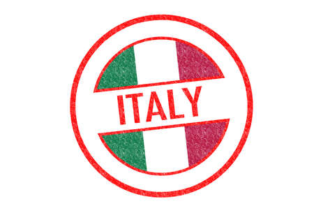 Passport-style ITALY rubber stamp over a white . photo