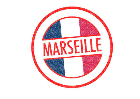 Passport-style MARSEILLE rubber stamp over a white . photo