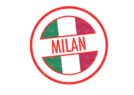 Passport-style MILAN rubber stamp over a white . photo