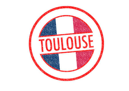 toulouse: Passport-style TOULOUSE rubber stamp over a white .
