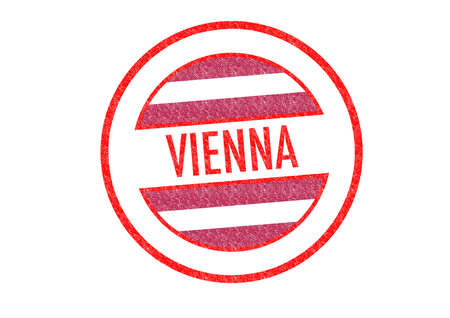 Passport-style VIENNA rubber stamp over a white background. photo