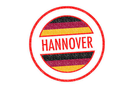 Passport-style HANNOVER rubber stamp over a white background. photo