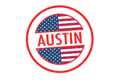 Passport-style AUSTIN rubber stamp over a white background. photo