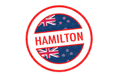 Passport-style HAMILTON rubber stamp over a white background. photo