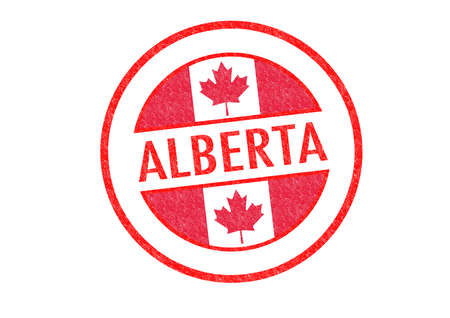 Passport-style ALBERTA rubber stamp over a white background. photo
