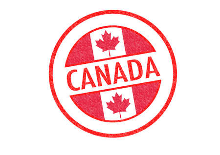 Passport-style CANADA rubber stamp over a white background. 版權商用圖片