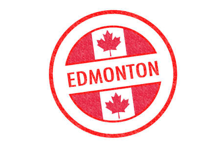 Passport-style EDMONTON rubber stamp over a white background.