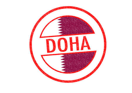 doha: Passport-style DOHA (Qatar) rubber stamp over a white background.