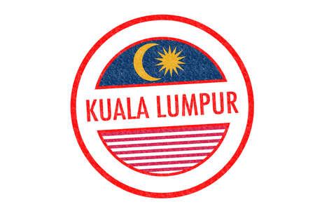 Passport-style KUALA LUMPUR rubber stamp over a white background. photo