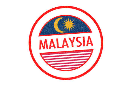 Passport-style MALAYSIA rubber stamp over a white background. photo