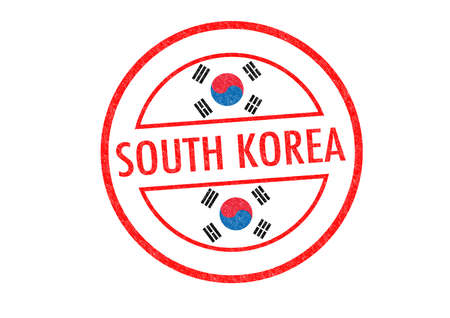 Passport-style SOUTH KOREA rubber stamp over a white background. photo