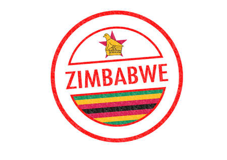 Passport-style ZIMBABWE rubber stamp over a white . photo