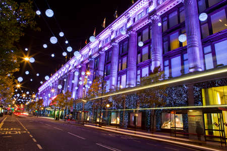 oxford street: LONDON, UK - DEC 1ST 2013: The illumintaed Selfridges store on Oxford Street during the Christmas period in London on 1st December 2013. Editorial
