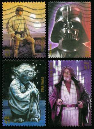 wan: UNITED STATES - CIRCA 2007: Four US postage stamps each depicting a character from the Star Wars movies (Luke Skywalker, Darth Vader, Yoda and Obi Wan Kenobi), circa 2007.