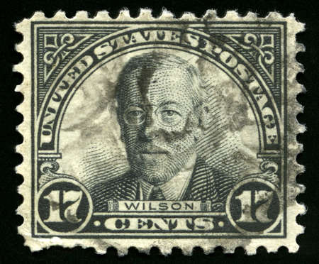 wilson: UNITED STATES, CIRCA 1920s: Vintage US Postage Stamp celebrating Woodrow Wilson, the twenty-eighth President of the United States of America, circa 1920s.