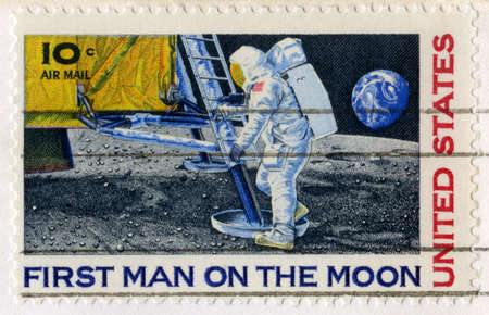 UNITED STATES, CIRCA 1969: A vintage 10 cent US Postal Stamp celebrating the First Moon Landing, circa 1969. photo